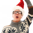 Funny man with glasses in christmas hat — Stock Photo #16688625