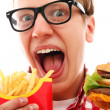 Funny man with french fries and hamburger — 图库照片