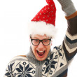 Funny man with glasses in christmas hat — Stock Photo #16688923