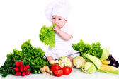 Baby cook with fresh vegetables — Stock Photo