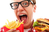Funny man with french fries and hamburger — Stock Photo