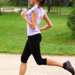 Stock Photo: Young and attractive girl running in the park