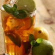 Fresh cold tea with lime, mint and lemon — Stock Photo #16851963