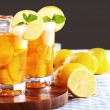 Fresh and cold ice tea with sliced lemon and mint — Stock Photo