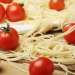 Tomatoes with spaghetti on square plate — ストック写真