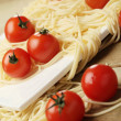 Tomatoes with spaghetti on square plate — Foto Stock