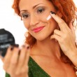 Beautiful redhead woman applying cream on a face — Foto de Stock