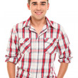 Handsome and young positive man smiling in studio — Stock Photo #16989847