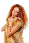Beautiful and attractive redhead woman in fur — Stock Photo