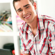 Handsome man working with laptop at home — Stock Photo