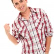 Handsome and young smiling man showing fist — Stock Photo #17124135