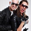 Young brutal couple in leather and sunglasses — Stock Photo