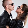 Young brutal couple in leather and sunglasses — Stockfoto