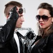 Young brutal couple in leather and sunglasses — Stock Photo #17160263