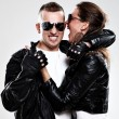 Young brutal couple in leather and sunglasses — Stock Photo #17160307