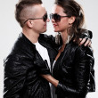 Young brutal couple in leather and sunglasses - Stock Photo