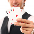 Handsome young man holding playing cards — Stock Photo