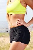 Corpo de mulher magra e desportivo close-up — Foto Stock