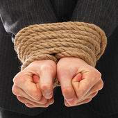 Close up of businessman hands tied with rope — Stock Photo