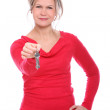Mid aged blonde holding keys in hand — Stock Photo #17192717