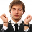 Handsome businessman hands in handcuffs — Stock Photo
