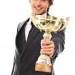 Handsome man in a suit with prize cup — Stock Photo