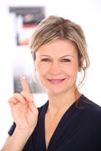 Beautiful mid aged blonde with cream on a finger — Stock Photo