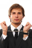 Handsome businessman hands in handcuffs — Stock Photo