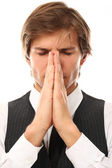 Handsome man in suit pray portrait — Stock Photo