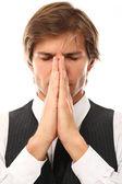 Takım elbiseli yakışıklı bir adam dua portre — Stok fotoğraf