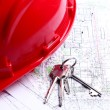 Architectural drawings, keys and red helmet — Stock Photo