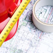 Architectural drawings, helmet and measure - Stock Photo