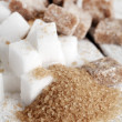 Stock Photo: Little heap of white and brown sugar cubes