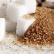 Little heap of white and brown sugar cubes — Stock Photo #17423829