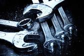 Closeup of wet iron spanners set — Stock Photo