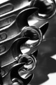 Closeup of iron spanners set with shadows — Stock Photo