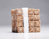 Square of brown and white sugar cubes stacked up — Stock Photo