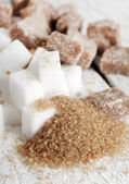 Little heap of white and brown sugar cubes — Stock Photo