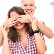 Handsome and smiling man closing girl`s eyes — Stock Photo #17463883