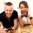 Stock Photo: Young couple emotionally play video games at home