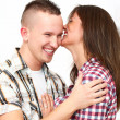 Happy couple embracing with kisses at home — Stock Photo