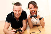 Young couple emotionally play video games at home — Stock Photo