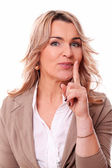 Mature woman quiet gesture on a white background — Stock Photo