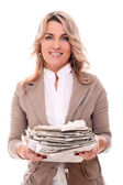 Mid aged woman in office suit with newspapers — Stock Photo