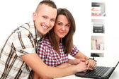 Happy young get leisure with laptop at home — Stockfoto