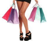 Woman legs in shoes and shopping bags — Stock Photo