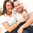 Beautiful couple smiling and looking at camera — Stock Photo