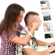 Girl closing guy's eyes which working with laptop — Stock Photo #17881191