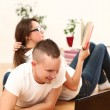 Young couple leisure at home with book and laptop — Stock Photo