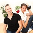 Young couple emotionally playing video games - Stok fotoğraf